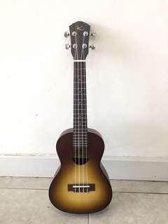 Used Ukulele made in Malaysia with tuner n free bag