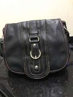 Emilie M. Full leather sling bag