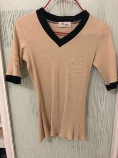 Nude top with black outline