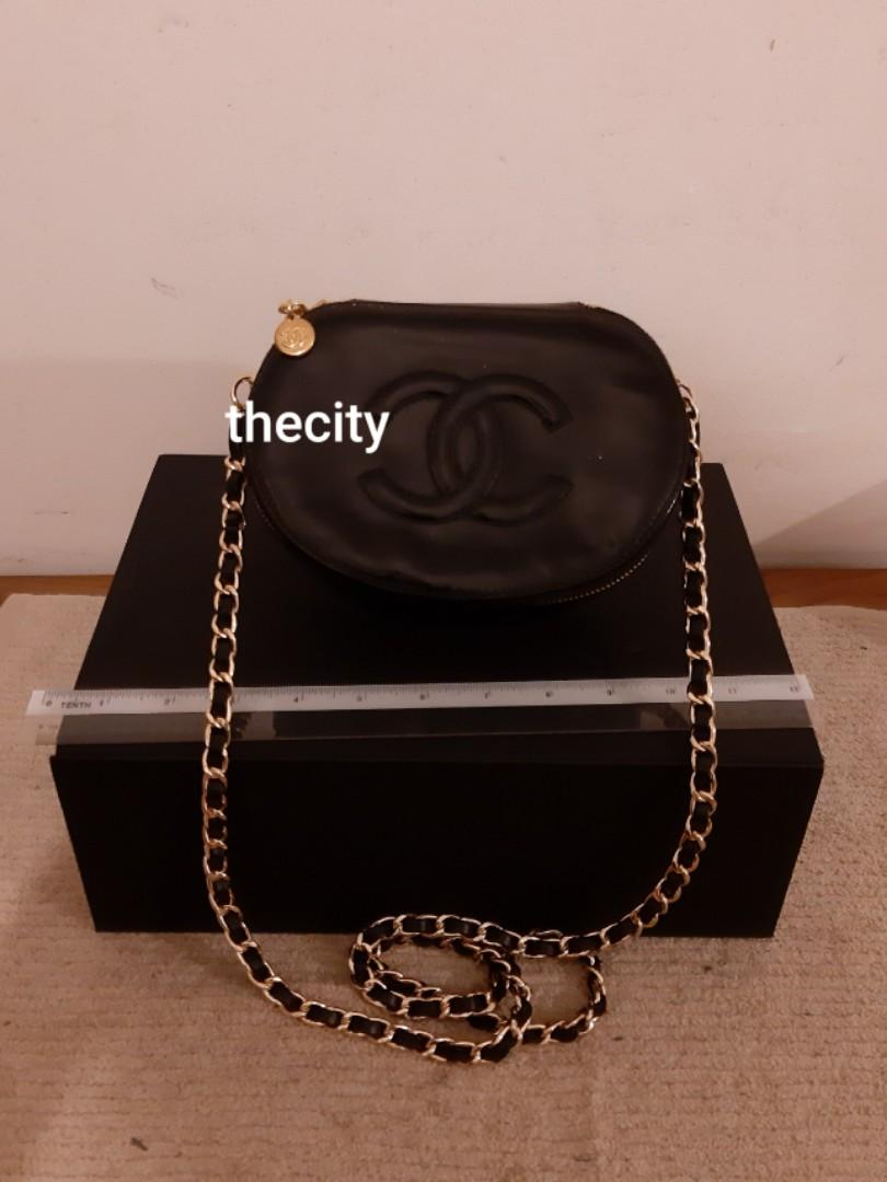 AUTHENTIC CHANEL ROUND VANITY CLUTCH BAG - CC LOGO DESIGN - IN SHINY BLACK PATENT LEATHER - GOLD HARDWARE - WITH MIRROR INSIDE- VERY CLEAN INTERIOR , SOLID SHAPE STRUCTURE - WITH EXTRA HOOKS & ADDITIONAL LONG STRAP