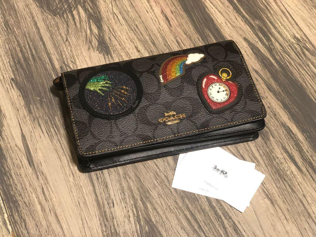 HAYDEN FOLDOVER CROSSBODY CLUTCH IN SIGNATURE CANVAS WITH WIZARD OF OZ PATCHES (COACH F39268) BLACK SMOKE/BLACK MULTI/LIGHT GOLD