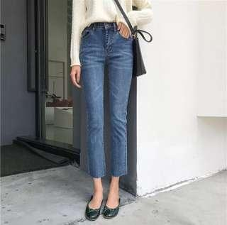 STRETCHY BLUE MID WAISTED JEANS