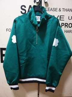 Stylish glossy green jacket with patches