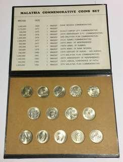 A set of 14 Malaysian 1 ringgit coin in display album.