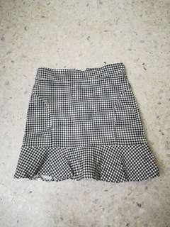 Checkered peplum skirt