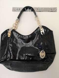 Re-price Michael Kors Sneak Skin Bag
