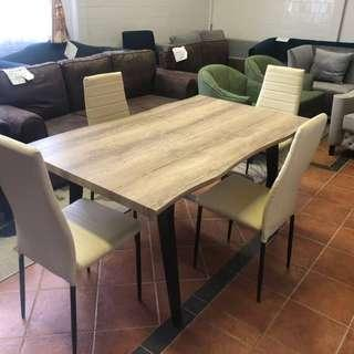 Affordavke timber table with natural curve and chairs