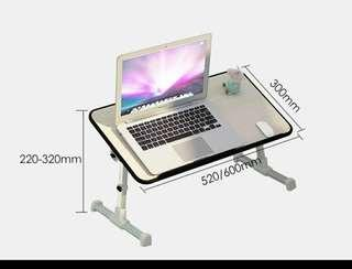 computer table on bed