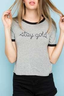 🚚 Brandy Melville stay gold embroidered Nadine grey ringer tee