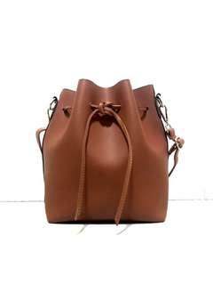 👜 Terracotta/Brown leather bucket bag