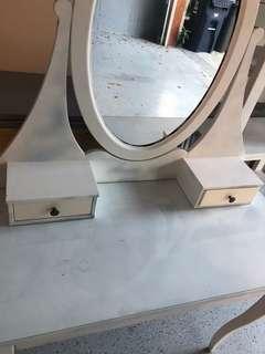 White wooden vanity dresser with mirror
