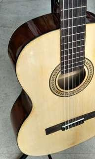 Brand new classical Guitar using Daddario strings(free capo, branded strings and Fender picks)