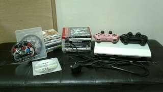 White PS3 console set with 16 games