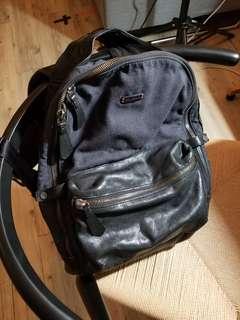 Local Designer leather + denim backpack