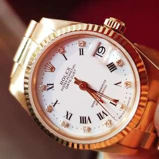 Genuine Rolex Boy-size 18k Yellow Gold Watch. White Porcelain face with Sparkling diamonds.   Model no. 68278. Working condition. Beautiful, no scratch on glass and no obvious scratch on gold surface.