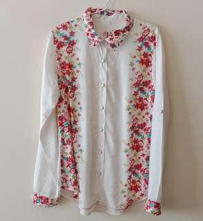 White flowery blouse