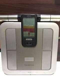 Omron body fat analyser and digital weighing scale