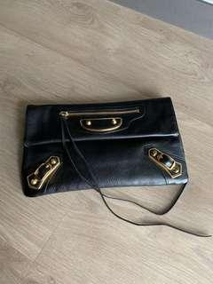 Authentic Balenciaga leather clutch bag