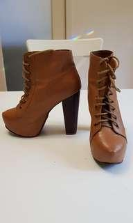 Tan high heeled boots