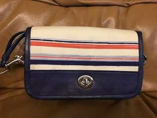 Coach canvas sling bag