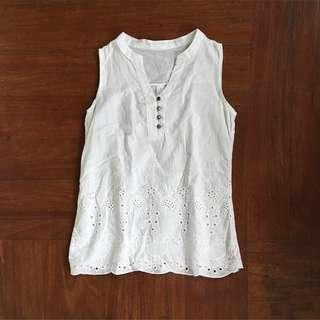 Sleeveless White Top with knitted details