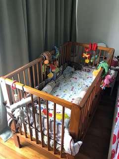 Baby crib wooden for sale in good condition.