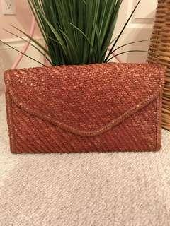 Large straw hand clutch bag