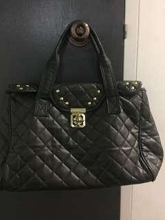 Black handbag with gold detailing