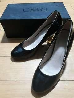 CMG black shoes with gold accent heels