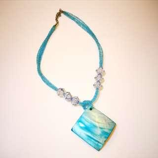 PRE💙D Beach Necklace With Blue Glass Delica Beads, Faceted Glass Bicones, and Big Rhombus Seashell Pendant