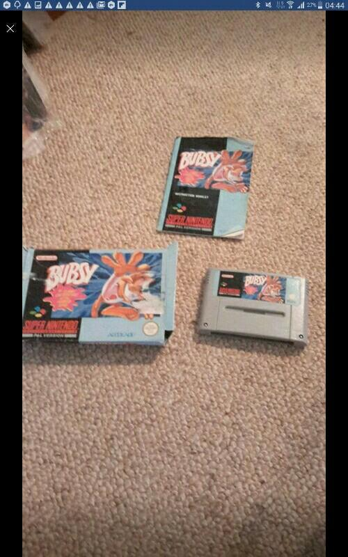 Super Nintendo games with original boxes and manuals