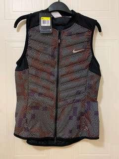 Brand new Nike reflective vest- size small