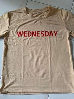Wednesday light orange beige tee shirt