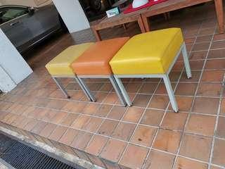 Colourful space saving chairs