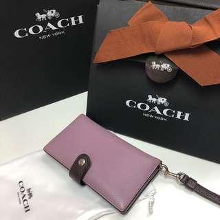 Coach 光滑鵝卵石顆粒皮革小型手腕包