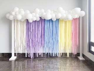 Rainbow balloon garland for backdrop and dessert table
