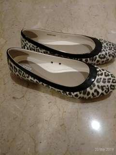 Crocs leopard print shoes