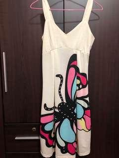 A huge butterfly at the front and back dress