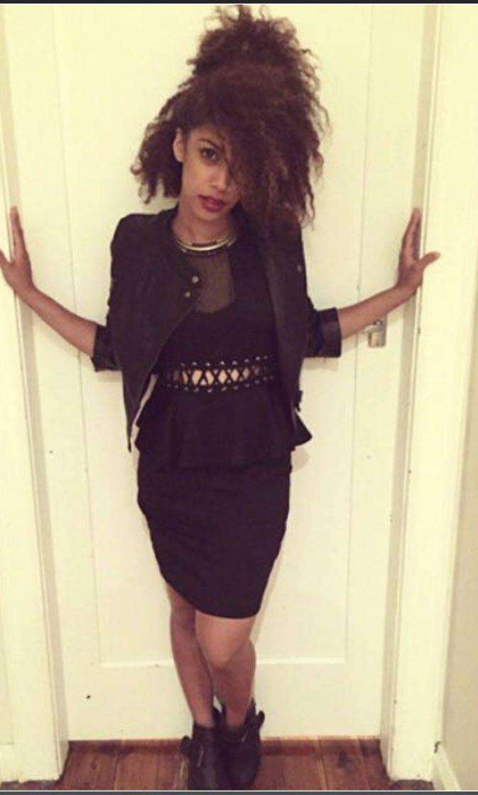 CLEAROUT SALE Black peplum dress with Criss cross cutout