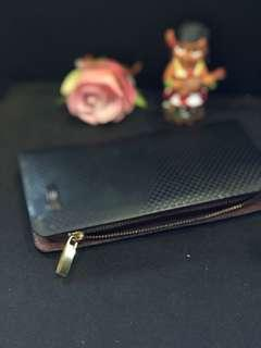Black zip-up wallet with flaw