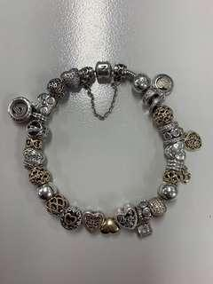 Authentic Pandora Bracelet with 14k Gold and Sterling Silver Charms