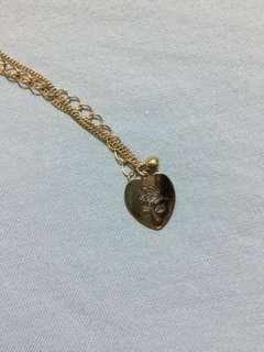 Heart necklace with rose engraved