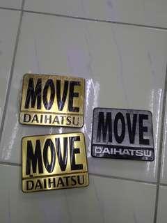 Daihatsu move gold emblem