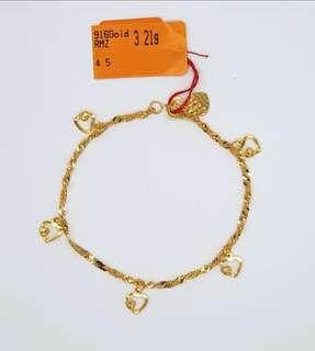 🚚 916 Gold Wave bracelet with dangling hearts
