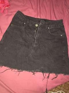 black ripped denim skirt