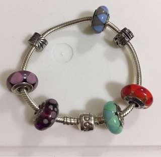 Authentic Pandora Bracelet with charms and stoppers