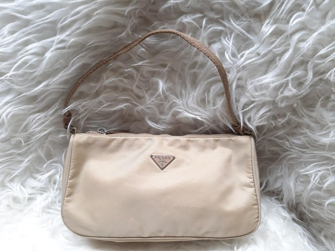 Price nett Fixed Price.. Thx  Authentic PRada Clutch/Pochette in Beige Nylon Preloved bag in Very Good condition💝💝