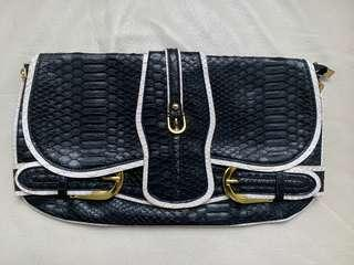 Clutch | black and white faux snake skin leather