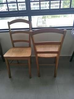 2 solid wooden chairs