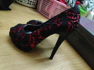 Laced high heel shoes